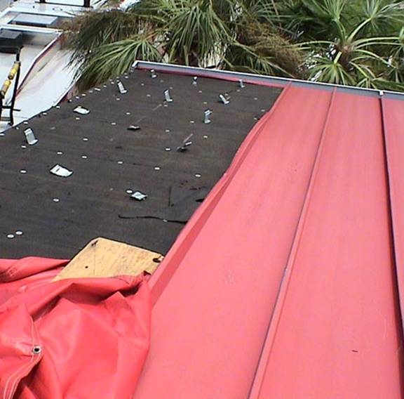 standing_seam_metal_roof_missing_panels_large